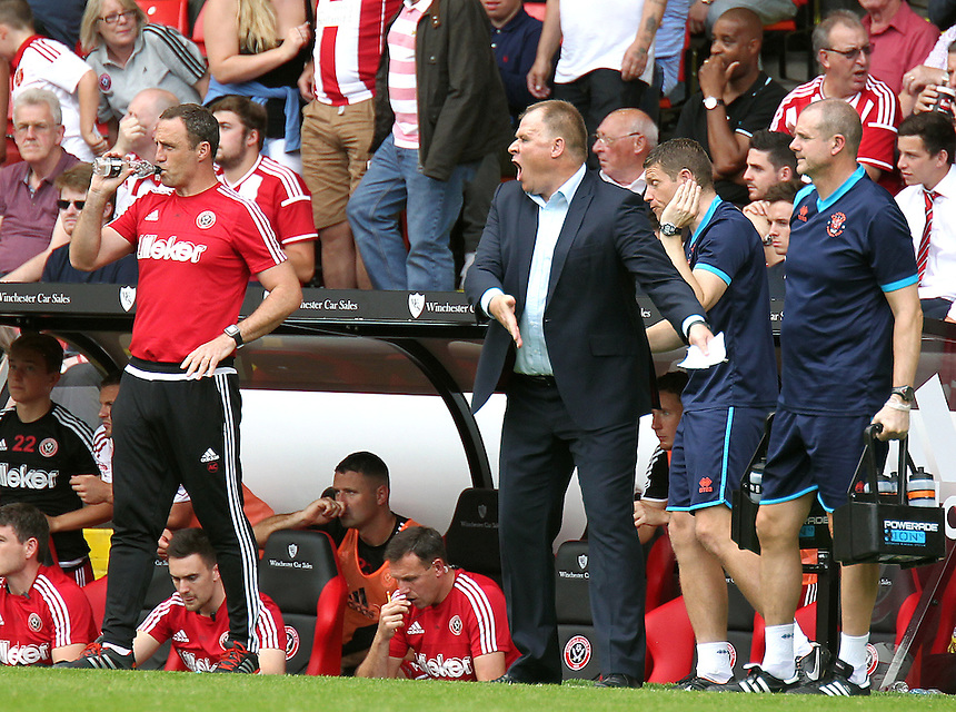 Blackpool manager Neil McDonald shouts instructions to his team from the dug-out<br /> <br /> Photographer Rich Linley/CameraSport<br /> <br /> Football - The Football League Sky Bet League One - Sheffield United v Blackpool - Saturday 22nd August 2015 - Bramall Lane - Sheffield<br /> <br /> &copy; CameraSport - 43 Linden Ave. Countesthorpe. Leicester. England. LE8 5PG - Tel: +44 (0) 116 277 4147 - admin@camerasport.com - www.camerasport.com