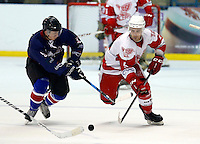 Sam Roberts (R) of Haringey competes for the puck with Alan Green during the National Ice Hockey League South Division 2 Cup - Group B game between Haringey Racers and Slough Jets at Alexandra Palace, London on Sat Sept 13, 2014.