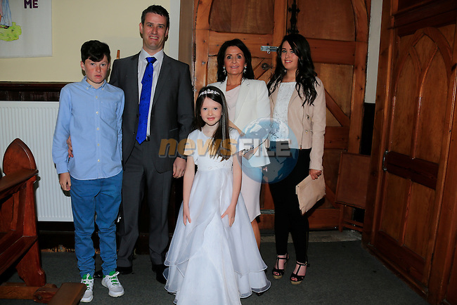 Allie Hughes, Jay,  Graham Aoife and Michelle  at first communion in Clogherhead church.<br /> Picture www.newsfile.ie