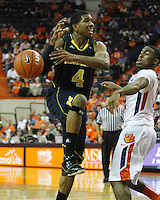 Nov 30, 2010; Clemson, SC, USA; Michigan Wolverines guard Darius Morris (4) has the ball knocked away by Clemson guard Cory Stanton (12) the game against the Clemson Tigers at Littlejohn Coliseum. Mandatory Credit: Daniel Shirey/WM Photo -US PRESSWIRE