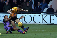 Jake Carroll of Cambridge United and Cristian Montano of Port Vale during Cambridge United vs Port Vale, Sky Bet EFL League 2 Football at the Cambs Glass Stadium on 9th February 2019