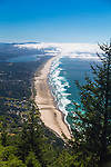 """Neahkahnie Beach in Manzanita, Oregon, a small beach town located in Tillamook County on the Northern Oregon coast.  Manzanita means """"little apple"""" in Spanish.  Neahkahnie Mountain is located at the north end of the 7 mile long beach. A hike up to the top of Neahkahnie Mountain reveals sweeping views of the beach and the town.  This hike is in Oswald West State Park"""