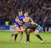 2nd February 2019, Halliwell Jones Stadium, Warrington, England; Betfred Super League rugby, Warrington Wolves versus Leeds Rhinos; Jack Hughes is tackled by  Stevie Ward and Brett Ferres