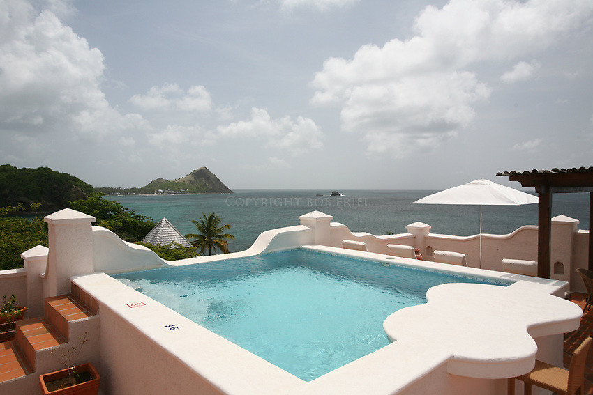 "Rootop plunge pool at Cap Maison ""villa"" suite. Pigeon Island in background."