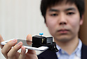 "March 9 2017, Tokyo, Japan - Go Kumagai, A student of University of Tokyo displays a small gadget to shoot panoramic picture with a smartphone ""Selfie 360"" at a presentation of All Nippon Airways (ANA) crowdfunding ""WonderFLY"" in Tokyo on Thursday, March 9, 2017. The Selfie 360 has a crockwork prismright-angled prism and which can take panoramic-view picture easily.    (Photo by Yoshio Tsunoda/AFLO) LwX -ytd-"