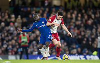 Ngolo Kante of Chelsea battles Gareth Barry of WBA during the Premier League match between Chelsea and West Bromwich Albion at Stamford Bridge, London, England on 12 February 2018. Photo by Andy Rowland.