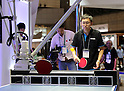 October 3, 2016, Chiba, Japan - Japanese electronics maker Omron receives the certification of the world's first robot table tennis tutor for the company's table tennis robot Forpheus from the Guinness World Record at a press preview of the CEATEC Japan 2016 in Chiba, suburban Tokyo on Monday, October 3, 2016. Asia's largest electronics trade show CEATEC will be held here from October 4 through 7.   (Photo by Yoshio Tsunoda/AFLO) LWX -ytd-