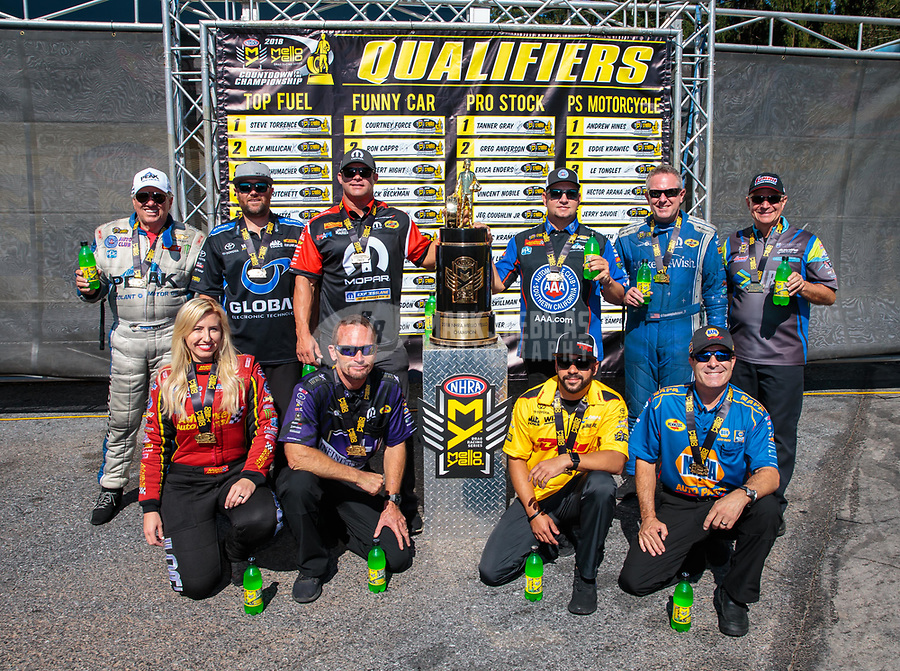 Sep 16, 2018; Mohnton, PA, USA; NHRA funny car drivers (front row from left) Courtney Force , Jack Beckman ,  J.R. Todd and Ron Capps (back row from left) John Force , Shawn Langdon , Matt Hagan , Robert Hight , Tommy Johnson Jr and Tim Wilkerson pose for a group photo with the championship trophy after qualifying for the NHRA countdown to the championship during the Dodge Nationals at Maple Grove Raceway. Mandatory Credit: Mark J. Rebilas-USA TODAY Sports