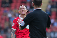 Sean Clohessy of Leyton Orient confronts the referee during the Sky Bet League 2 match between Leyton Orient and Wycombe Wanderers at the Matchroom Stadium, London, England on 19 September 2015. Photo by Andy Rowland.