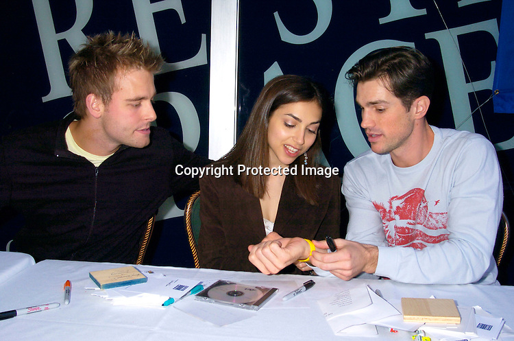 Jay Wilkison, Eden Riegel and Matt Cavenaugh ..at the Broadway Cares/ Equity Fights Aids Flea Market and Grand Auction on September 19, 2004 in Shubert Alley...Photo by Robin Platzer, Twin Images