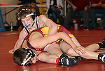SIOUX FALLS, SD - DECEMBER 28:  Jacob Puppe from Brookings has control of Brandon Carroll from Roosevelt in their 106 pound championship match Saturday afternoon December 28, 2013 at Lincoln High School in Sioux Falls, South Dakota. (Photo by  Dave Eggen/Inertia)