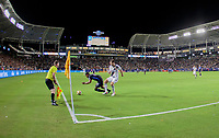CARSON, CA - SEPTEMBER 21: Dave Romney #4 of the Los Angeles Galaxy pushes Shamit Shome #28 of the Montreal Impact off the ball during a game between Montreal Impact and Los Angeles Galaxy at Dignity Health Sports Park on September 21, 2019 in Carson, California.