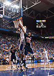 Freshman forward Willie Cauley-Stein rebounds and dunks the ball over Samford guard Jaylen Beckham during the second half of the Men's Basketball game vs. Samford at the Rupp Arena in Lexington, Ky., on Tuesday, December 4th, 2012..