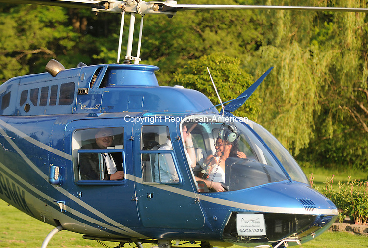 SOUTHINGTON, CT-21 MAY 2010-052110IP03- (l to r) Kennedy High School students Jon Greco and Mercedes Caban sit in the helicopter they flew in to their senior prom as it lands on the grounds of the Aqua Turf Club in Southington on Friday. They rented the helicopter with fellow students Roberto Quinones and Melissa DeCosmo. The helicopter was piloted by Andrew Hayden of AirOcean Aviation, LLC.                                                                                                                                                                                                                                                                                                                                                                                                                                                                                                                                                                                                                                                                                                                                                                                                                                                                                                                                                                                                                                                                                                                                                                                                                                                                                                                                                                                                                                                                                                                    <br /> Irena Pastorello Republican-American
