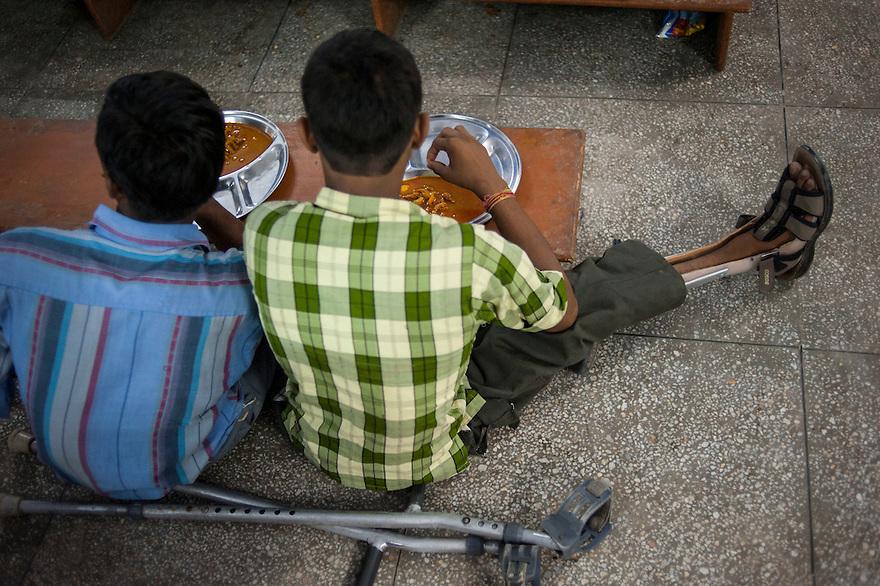 Two students having their evening meal at the Sucheta Kriplani Shiksha Niketan school for disabled children.