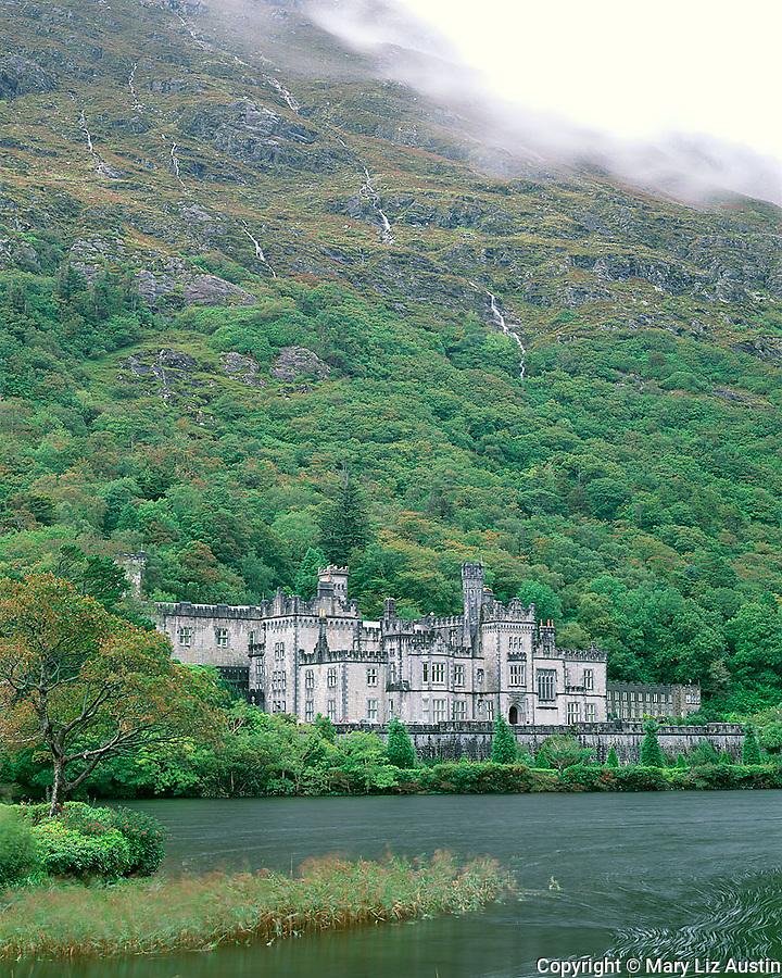 County Galway, Ireland<br /> Kylemore Abbey under the slopes of the Twelve Bens, Kylemore Lough, Connemara region