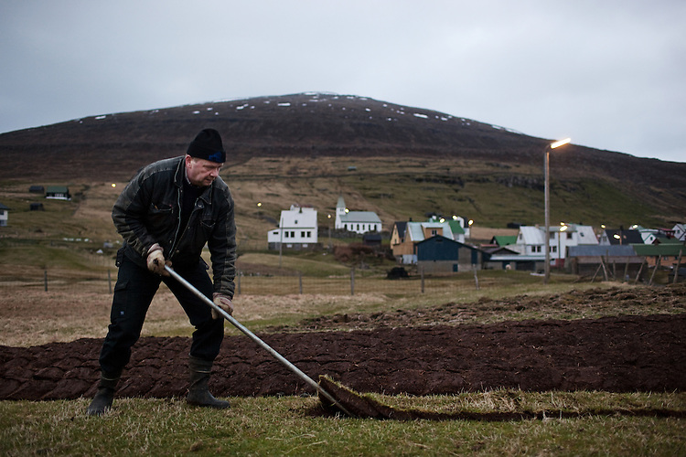 A man plants potatoes on the island of Svínoy in the Faroe Islands.
