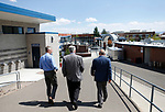 University of Nevada, Reno Athletic Director Doug Knuth, left, takes Democratic governor candidate Steve Sisolak, center, and Raiders president Marc Badain on a tour of their athletic facilities in Reno, Nev., on Thursday, Aug. 16, 2018. The Raiders are considering several potential training camp locations in Reno. (Cathleen Allison/Las Vegas Review-Journal)