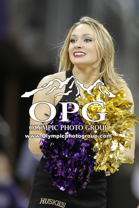 JAN 1, 2016:  Washington cheer leader Tess Lombard-Henley entertained fans during the game against UCLA.  Washington defeated #25 ranked UCLA 96-93 in double overtime at Alaska Airlines Arena in Seattle, WA.