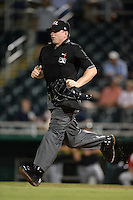 Umpire Ryan Benson gets in position to make a call during a game between the Tampa Yankees and Fort Myers Miracle on April 15, 2015 at Hammond Stadium in Fort Myers, Florida.  Tampa defeated Fort Myers 3-1 in eleven innings.  (Mike Janes/Four Seam Images)