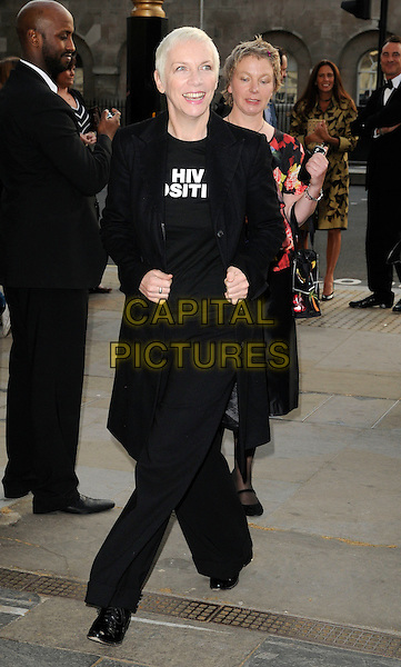 ANNIE LENNOX .attending the Women For Women Gala and awards, Banqueting House, London, England, UK, May 5th 2011..full length black coat trousers HIV positive t-shirt slogan .CAP/CAN.©Can Nguyen/Capital Pictures.