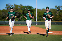 Dartmouth Big Green left fielder Kyle Holbrook (9) jogs off the field in between center fielder Matt Feinstein (23) and shortstop Nate Ostmo (5) during a game against the Northeastern Huskies on March 3, 2018 at North Charlotte Regional Park in Port Charlotte, Florida.  Northeastern defeated Dartmouth 10-8.  (Mike Janes/Four Seam Images)