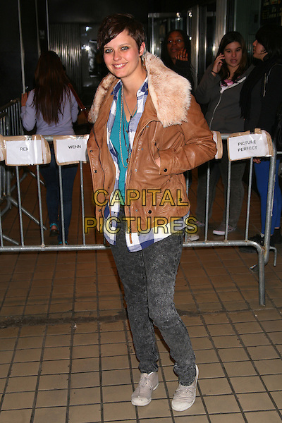 """KIM STOLZ.The Premiere of """"Solitary Man"""" at Cinema 2, New York, NY, USA..May 11th, 2010.full length hands in pockets brown leather jacket jeans denim acid wash blue white  fur collar beige .CAP/LNC/TOM.©TOM/LNC/Capital Pictures."""