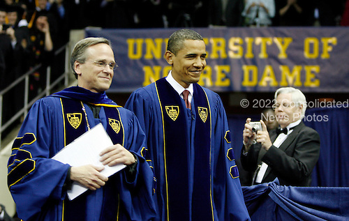 South Bend, IN - May 17, 2009 -- United States President Barack Obama and University President Rev. John I. Jenkins (L) walk in for the 164th commencement ceremonies at the University of Notre Dame in South Bend, Indiana, May 17, 2009.  .Credit: Jeff Haynes / Pool via CNP
