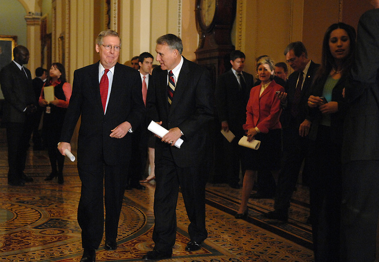 Senate Minority Leader Mitch McConnell, R-Ky., left, and Sen. Jon Kyl, R-Ariz., make their way to the podium after the senate luncheons.  Sens. Trent Lott, D-Miss., and Kay Bailey Hutchison, R-Texas, follow behind.