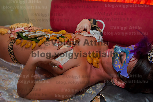 Following japanese traditions sushi is served on the bodies of naked women in a club in downtown Budapest, Hungary on September 23, 2011. ATTILA VOLGYI