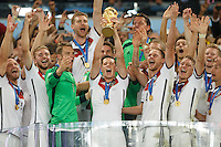 Julian Draxler of Germany lifts the World Cup trophy after winning the 2014 final celebrating with team mates