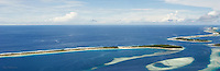 Jaluit Atoll from the air is, like most atoll islands, a thin strip of land circling a turquoise lagoon: fragile and exquisitely beautiful.