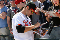 March 8, 2010:  Pitcher Jake Arrieta (57) of the Baltimore Orioles signs autographs before a Spring Training game at Ed Smith Stadium in Sarasota, FL.  Photo By Mike Janes/Four Seam Images