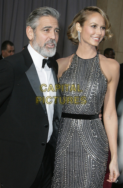 George Clooney, Stacy Keibler.85th Annual Academy Awards held at the Dolby Theatre at Hollywood & Highland Center, Hollywood, California, USA..February 24th, 2013.oscars half length black  tuxedo beard facial hair grey gray silver metallic sleeveless beads beaded dress belt couple .CAP/ADM.©AdMedia/Capital Pictures.