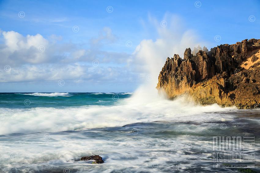 At sunrise, a powerful wave breaks on the pinnacles (a.k.a. The Pinnacles) along the Maha'ulepu Heritage Trail, South Kaua'i.