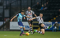 Scott Kashket of Wycombe Wanderers hits a shot under pressure from Haydn Hollis of Notts Co during the Sky Bet League 2 match between Notts County and Wycombe Wanderers at Meadow Lane, Nottingham, England on 10 December 2016. Photo by Andy Rowland.