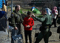 Pictured: Greek police speak to a young boy Tuesday 01 March 2016<br /> Re: Thousands of migrants, still stranded at the Greek FYRO Macedonian border in Idomeni, Greece