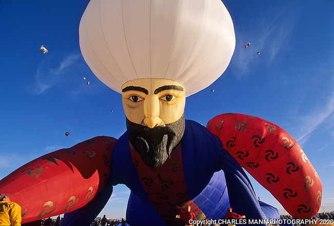 A giant Ali Baba balloon rises to fly at the Albquuerque International Hot Air Balloon Fiesta