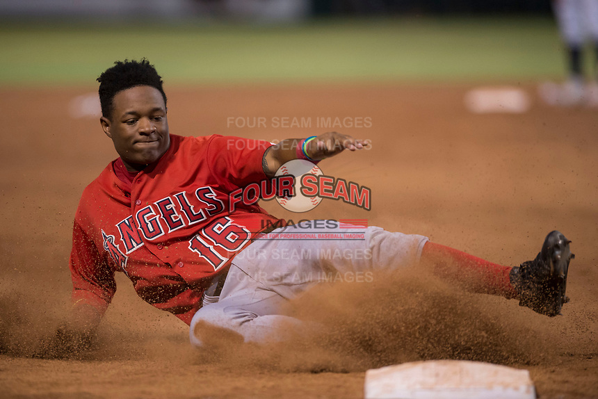 AZL Angels left fielder Datren Bray (16) slides into third base during an Arizona League game against the AZL Indians 2 at Tempe Diablo Stadium on June 30, 2018 in Tempe, Arizona. The AZL Indians 2 defeated the AZL Angels by a score of 13-8. (Zachary Lucy/Four Seam Images)