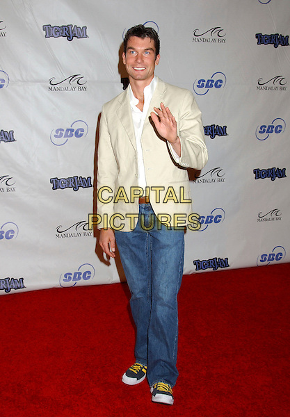JERRY O'CONNELL.Tiger Jam VIII benefiting the Tiger Woods Foundation held at Mandalay Bay Resort & Casino, Las Vegas, Nevada.May 21st, 2005.Photo Credit: Laura Farr/AdMedia.full length jeans denim trainers sneakers beige white suit jacket waving gesture.www.capitalpictures.com.sales@capitalpictures.com.© Capital Pictures.