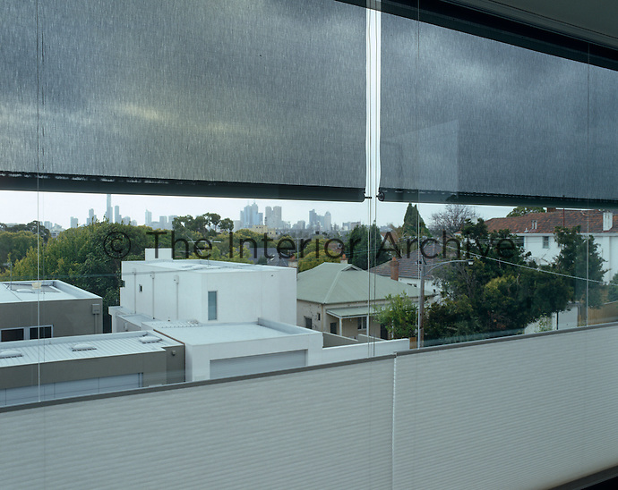 The large picture window in the master bedroom has a view across Melbourne