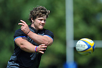 Nick Auterac passes the ball. Bath Rugby pre-season training session on July 18, 2014 at Farleigh House in Bath, England. Photo by: Patrick Khachfe/Onside Images