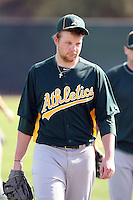 Brett Anderson #49 of the Oakland Athletics participates in spring training workouts at the Athletics complex on February 23, 2011  in Phoenix, Arizona. .Photo by:  Bill Mitchell/Four Seam Images.