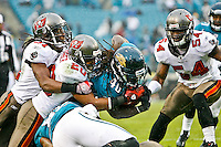 December 11, 2011: Tampa Bay Buccaneers cornerback Ronde Barber (20) tries to stop Jacksonville Jaguars running back DuJuan Harris (40) who dives for yardage while trying to score on a two point conversion during second half action between the Jacksonville Jaguars and the Tampa Bay Buccaneers played at EverBank Field in Jacksonville, Florida.  Jacksonville defeated Tamp Bay 41-14.........