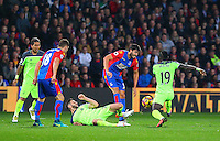 Adam Lallana of Liverpool and Sadio Mane of Liverpool tackle as James Tomkins of Crystal Palace tries to clear during the EPL - Premier League match between Crystal Palace and Liverpool at Selhurst Park, London, England on 29 October 2016. Photo by Steve McCarthy.