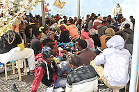 Migrants stand in the dock after the disembark   the Italian Navy vessel 'Bettica' in the harbor of Salerno, Italy, 05 May, 2015