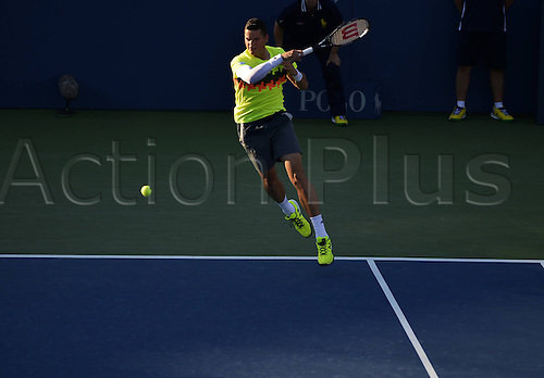 25.08.2014. Flushing Meadows, NY, USA. Milos Raonic of Canada competes during the men s singles 1st round match agasint Taro Daniel of Japan at the U.S. Open tennis tournament in New York, the United States, on Aug. 25, 2014. Raonic 3-0.