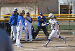 Wildcats' Assistant Coach Bethany Henry-Herman congratulates Meghan Hospodka after she hit a three-run homer in a college softball game against Snow College at Edmonds Sports Complex in Carson City, Nev., on Friday, March 6, 2014. <br /> Photo by Cathleen Allison/Nevada Photo Source