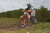 These are photos from the Loose Moose Enduro and Mini Moose held in Marquette Michigan on June 13th and 14th, 2015. The Mini Moose starts with #136373 and the Loose Moose starts with #136441. You may order prints from this site or you may download jpegs for personal use. Please use the &quot;Add To Cart&quot; feature not the Download button. There are two sizes available for download: 500 pixels wide or tall for used on Facebook or 1500 pixels if you would like a larger one for your computer or on your personal web site. If you have any questions, please contact me at: tbuchkoe@chartermi.net. Please do not remove the &copy;Tom Buchkoe as it is a violation of federal law. <br />