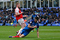 Jack Baldwin of Peterborough United and Paddy Madden of Fleetwood Town during the Sky Bet League 1 match between Peterborough and Fleetwood Town at London Road, Peterborough, England on 28 April 2018. Photo by Carlton Myrie.